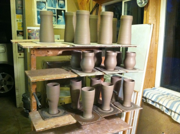 Cup forms just off the wheel with no handles yet.